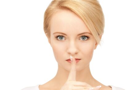 bright picture of young woman with finger on lips Stock Photo - 9059190