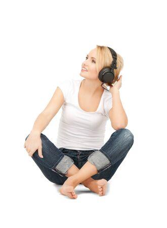 picture of happy teenage girl in big headphones Stock Photo - 9059186