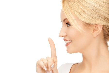 bright picture of young woman with finger on lips Stock Photo - 9059258