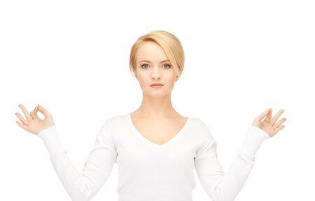 bright picture of woman in meditation over white photo