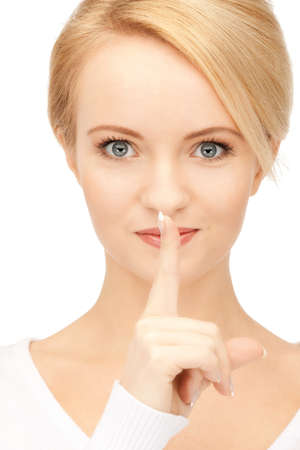 bright picture of young woman with finger on lips Stock Photo - 9162902
