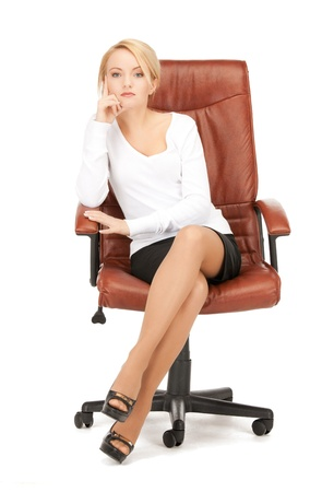 sitting: picture of young businesswoman sitting in chair
