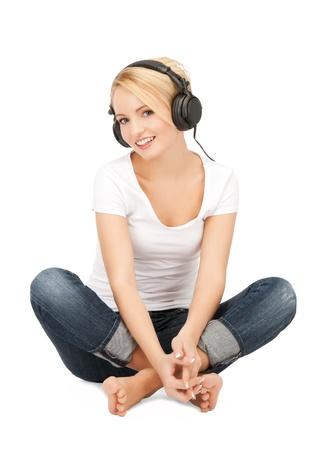 girl headphones: picture of happy teenage girl in big headphones