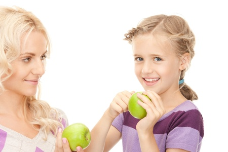 picture of mother and little girl with green apple photo