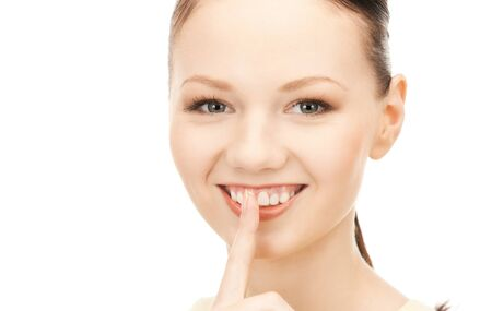 bright picture of young woman with finger on lips Stock Photo - 9160890
