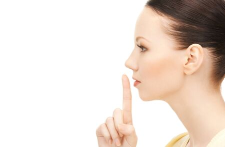 bright picture of young woman with finger on lips Stock Photo - 9160889