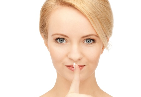 bright picture of young woman with finger on lips Stock Photo - 9160900