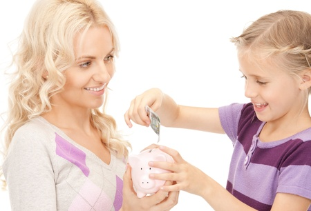 picture of mother and little girl with piggy bank Stock Photo - 9162929