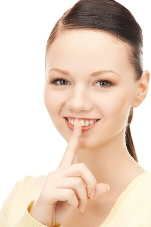 bright picture of young woman with finger on lips Stock Photo - 9160972