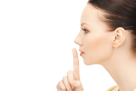 bright picture of young woman with finger on lips Stock Photo - 9162457
