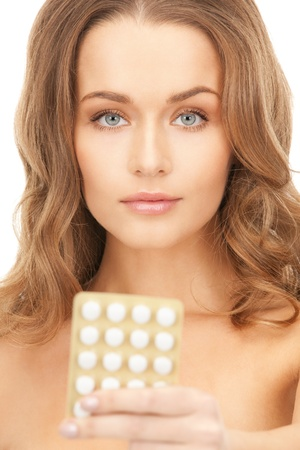 birth prevention: picture of young beautiful woman with pills