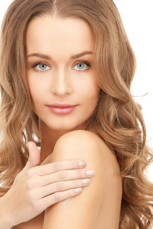 soft skin: picture of beautiful woman with moisturizing creme