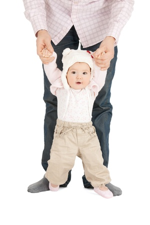 picture of baby making first steps with father help photo