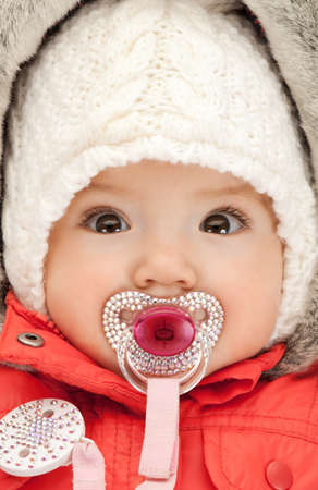 bright picture of adorable baby with pacifier photo