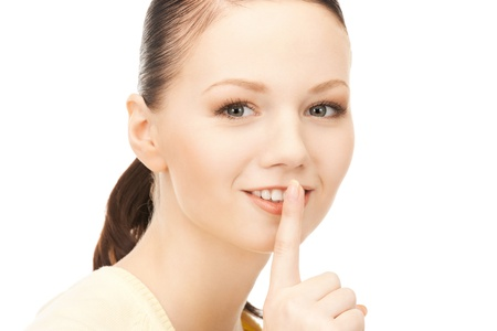 bright picture of young woman with finger on lips Stock Photo - 9161053
