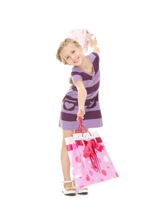 ni�os de compras: foto de la ni�a con bolsas de compra