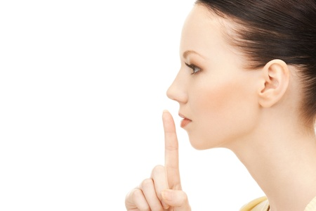 bright picture of young woman with finger on lips Stock Photo - 9193275