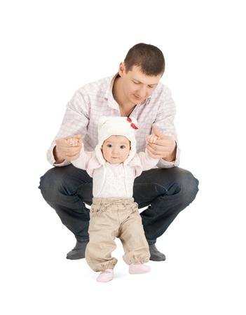 ni�os caminando: foto de beb� haciendo primeros pasos con ayuda del padre