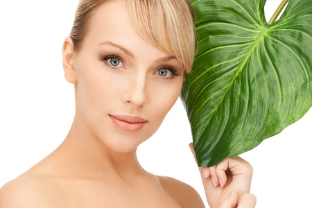 gentle: picture of woman with green leaf over white