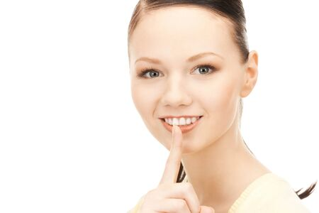 bright picture of young woman with finger on lips Stock Photo - 9193034