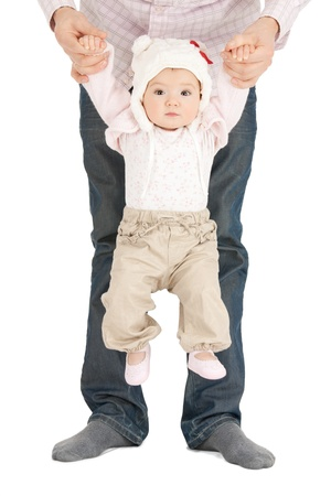picture of baby hanging on fathers hands photo