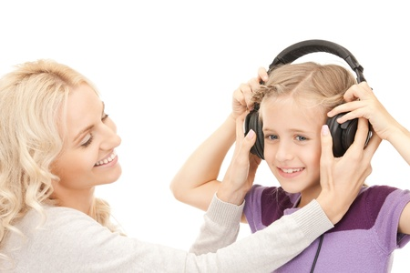picture of mother and little girl with headphones  photo