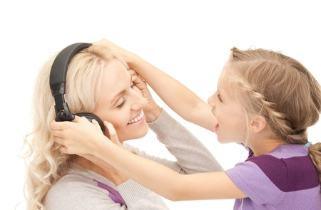 picture of mother and little girl with headphones. photo