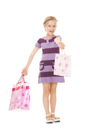 picture of little girl with shopping bags. photo