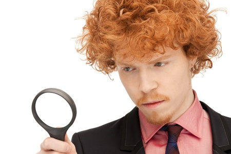 picture of handsome man with magnifying glass Stock Photo - 9318964