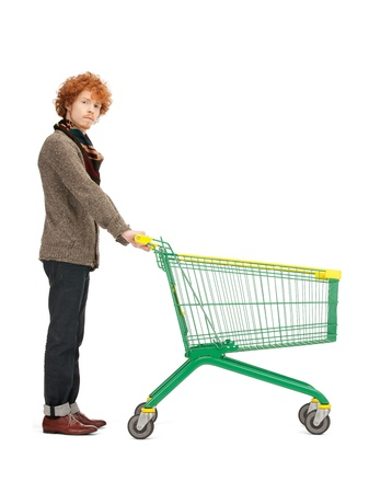 bright picture of handsome man with shopping cart Stock Photo - 9318813