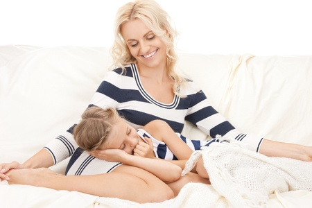 bright picture of happy mother and sleeping girl. photo