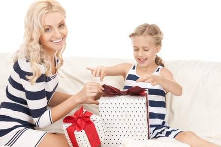 picture of mother and little girl with gifts (focus on daughter). photo