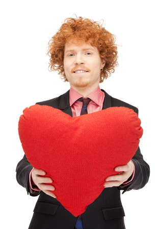 picture of handsome man with red heart-shaped pillow photo