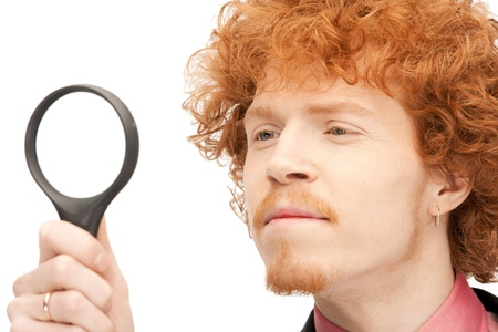 picture of handsome man with magnifying glass Stock Photo - 9318966