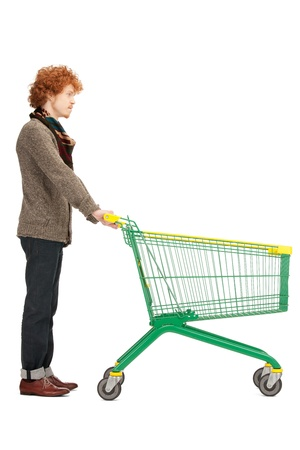 bright picture of handsome man with shopping cart photo