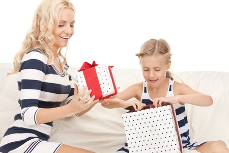picture of mother and little girl with gifts. photo