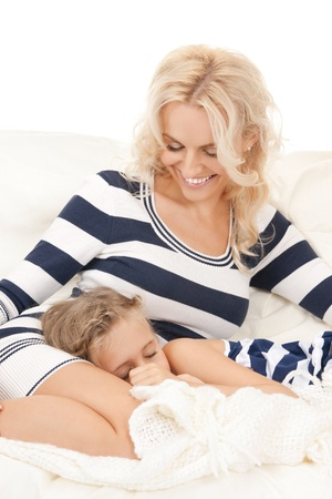 bright picture of happy mother and sleeping girl  photo