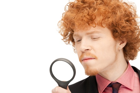 picture of handsome man with magnifying glass Stock Photo - 9373233