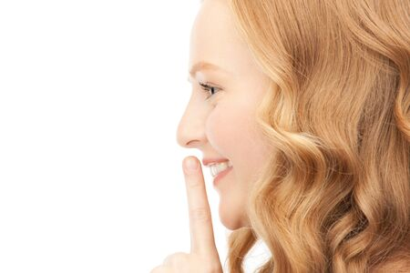 bright picture of young woman with finger on lips Stock Photo - 9357708
