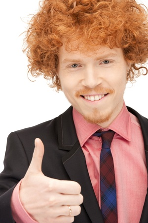 bright picture of handsome man with thumbs up photo