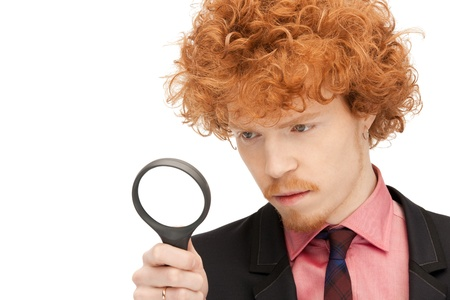 picture of handsome man with magnifying glass Stock Photo - 9354559