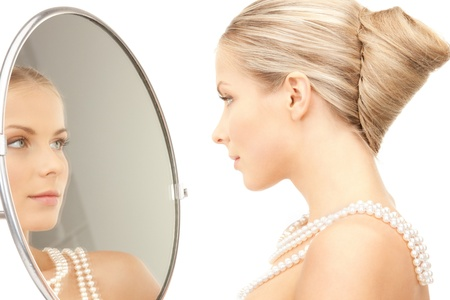 woman mirror: picture of beautiful woman with pearl beads and mirror