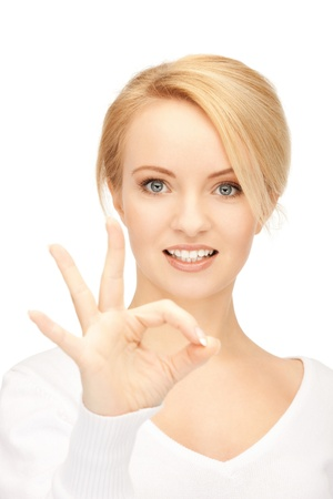 bright picture of lovely teenage girl showing ok sign photo