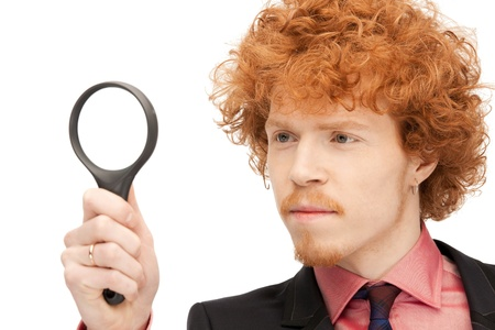 picture of handsome man with magnifying glass Stock Photo - 9362111