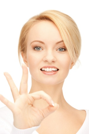 bright picture of lovely teenage girl showing ok sign Stock Photo - 9373123