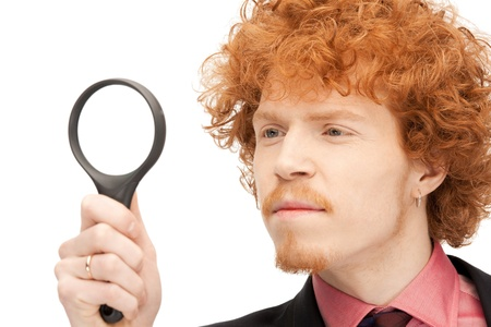 picture of handsome man with magnifying glass Stock Photo - 9373140