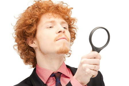 picture of handsome man with magnifying glass photo