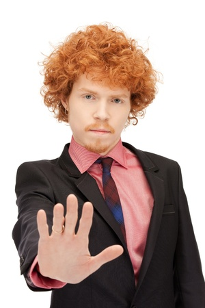 bright picture of young man making stop gesture Stock Photo - 9393659