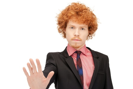 bright picture of young man making stop gesture Stock Photo - 9407935