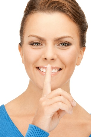bright picture of young woman with finger on lips Stock Photo - 9407959
